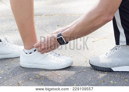 Close Up Of Love Couple Tie Up The Shoe For Girlfriend To Be Ready For An Exercise In The Park In Th
