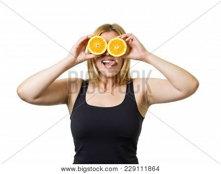 Young Cheerful European Woman With Blond Hair And Big Orange Eyes. Healthy Eating, Raw Food Concept