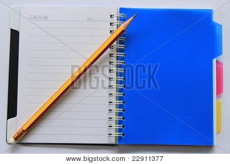 Pencil On Open Note Book