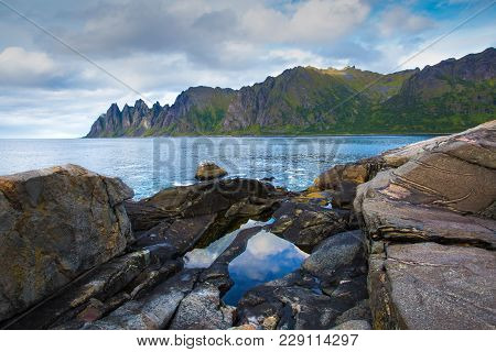 Stone Seaside Of Norway. Sunny Spring Day On Senja Islland, Norway. Famous Stone North Seaside.