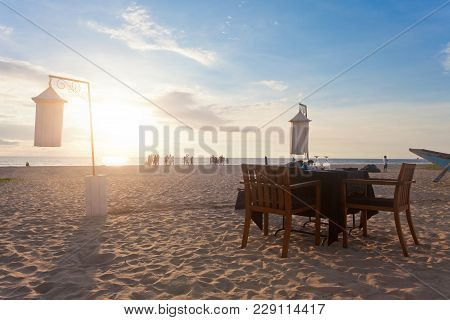 Ahungalla, Sri Lanka, Asia - A Single Table At Ahungalla Beach Prepared For Dinner For Two During Su