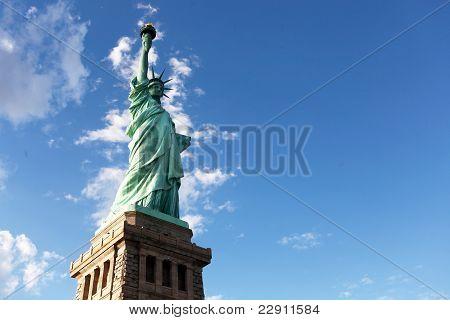 Statue of liberty facing harbor