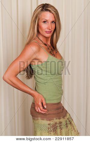 Beautiful mature blonde dressed in hippie attire poster