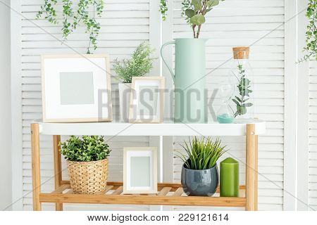 Stand With Decor And Vases In The Room. Concept Interior, Decoration, Comfort In The House.