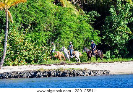 Santo Domingo, Dominican Republic - October 29, 2015: Unidentified Tourists Riding Horses On Beach I