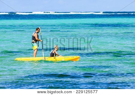 Santo Domingo, Dominican Republic - October 29, 2015: Happy Couple On Vacation Doing Kayaking In Oce
