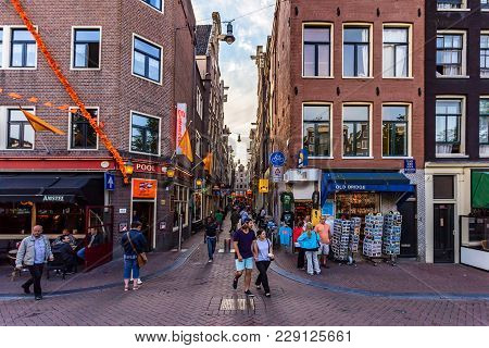 Amsterdam, The Netherlands - June 10, 2014: Beautiful Sreets Of Amsterdam With Shops On Summer Day.