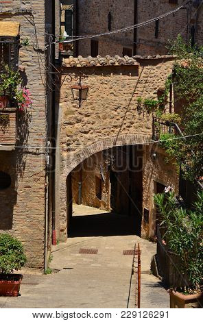 Medieval Arch With Lamp In The Historic Center Of Montone, A Small Town In The Umbria Countryside In