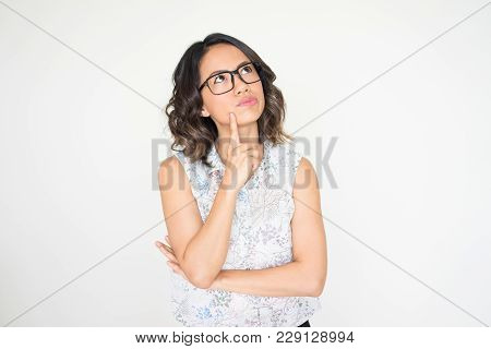 Closeup Portrait Of Thoughtful Young Pretty Woman Touching Face. Contemplation Concept. Isolated Fro