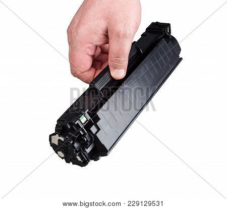 Cartridge For Printer In Hand, Isolated On White Background.