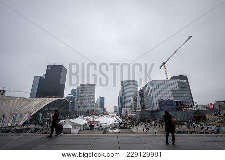 Paris, France - December 20, 2017: People Contemplating La Defense District Skyline From The Esplana