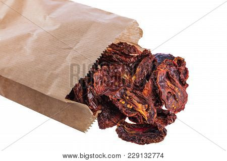 Sun-dried Sweet Tomatoes In Paper Packet Isolated On White Background.