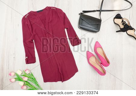 Fashion Concept. Burgundy Blouse, Handbag, Pink And Black Shoes, Tulips. Top View