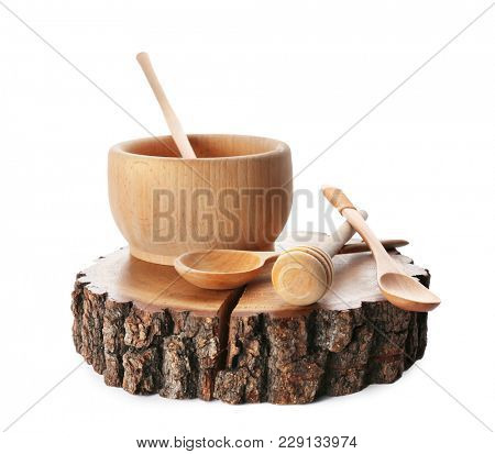 Wooden kitchen utensils on white background