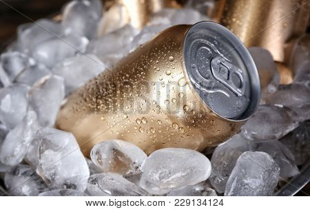 Cans of beer in ice, closeup