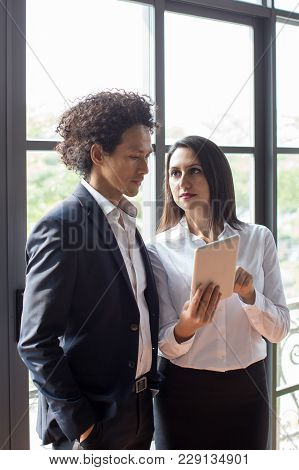 Disturbed Business Lady Showing Information On Tablet To Coworker. Coworkers Analyzing Information O