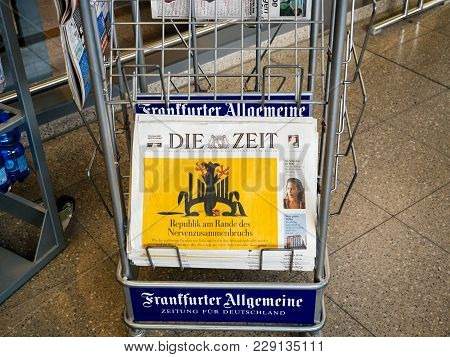 Berlin, Germany - Feb 8, 2018: Man Holding Buying Die Zeit German Politic News Paper At Press Kiosk