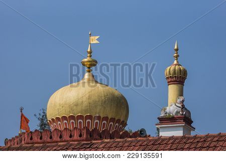 Madikeri, India - October 31, 2013: Shree Omkareshwara Temple. Short Turret And Bull Plus Top Gold-y