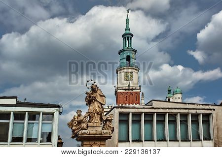 Monument, Townhouses And Town Hall At The Old Market In Poznan