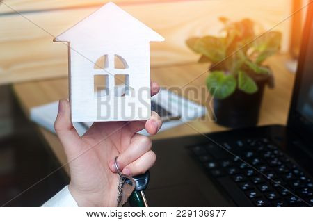 keys and a small house in hands. real estate agent. concept of buying apartments, selling apartments, renting a home. construction, mortgage, propertyconstruction, mortgage, property