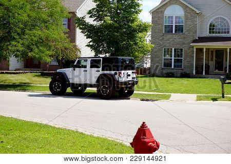 Joliet, Illinois / United States - July 30, 2017: A White Jeep Rubicon Wrangler Unlimited Is Parked