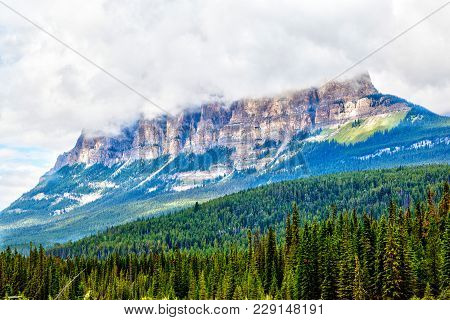 Clouds Descend On Top Of Castle Mountain In Banff National Park, Canada, At The Eastern Ranges Of Th