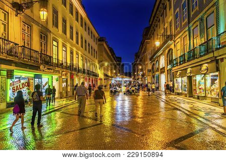 Lisbon, Portugal - September 11, 2017 Rua Augusta Street Evening Walking Shopping Street Black White