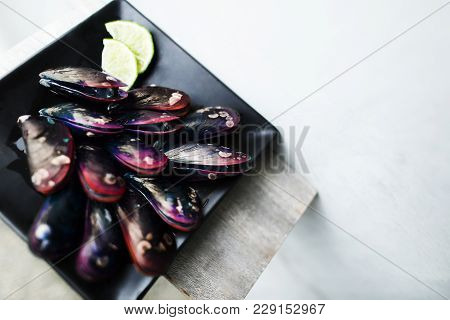 Concept Of Expensive Raw Red Purple Oyster Delicatessen With Lemon For Lunch Or Dinner, Luxury Food