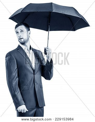 Friendly Surprised Businessman Holding An Umbrella Isolated On White. Protection Concept.