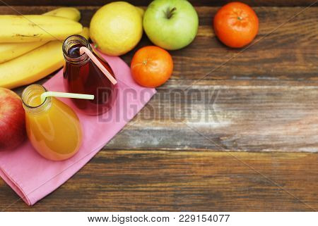 Organic Fruit Juice In Glass Bottle On Rustic Wooden Wood Background. Healthy Life Living Diet And F