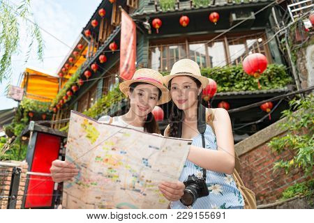 Happy Two Asian Women Tourist Walking Around The Country Jiufen Of Taipei City, Looking Searching On