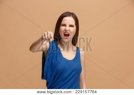I choose you and order. Overbearing woman point you, want you, half length closeup portrait on pastel studio background. The human emotions, facial expression concept. Front view. Trendy colors poster