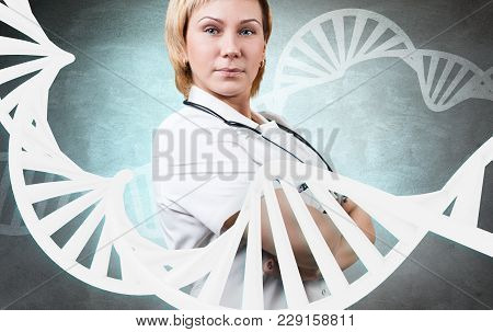 Portrait Of Woman Doctor Standing Over Gray Wall Background With A Large Dna Chain.