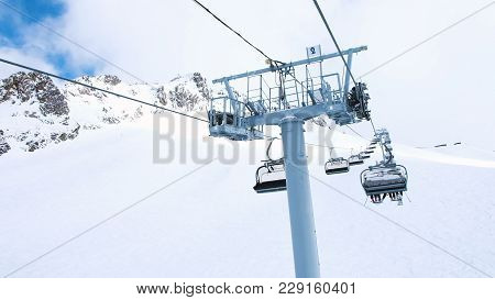 View From The Chairlift In Motion To The Top, Four-seat Lifts Work At The Ski Resort, Slow Motion.