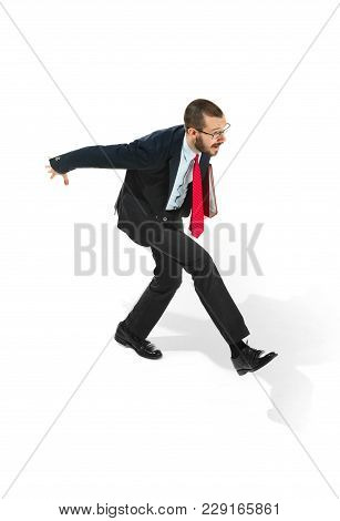 Businessman Running With A Folder Isolated On White Background. Serious Bearded Young Man In Glasses
