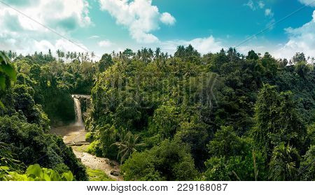 Waterfall Panorama In Amazonian Tropical Rainforest With Big River In The Middle Of Jungle