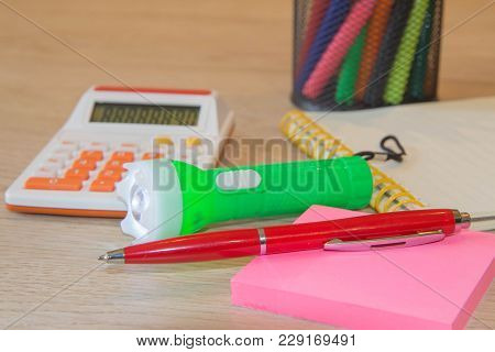 Calculator And Pen With Documents Close Up. Sales Report Analysis With Pen And Calculator