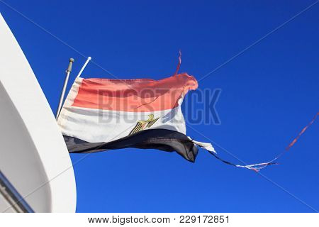 Flag Of Egypt Waving In The Wind.