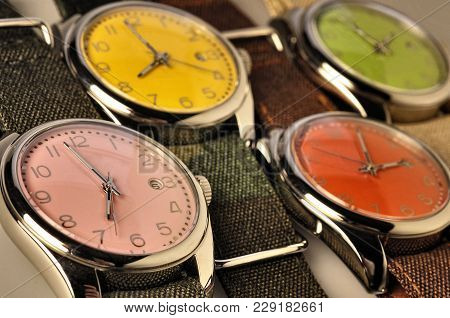 Four Colorful Watches In Perspective And Low Deep Of Field
