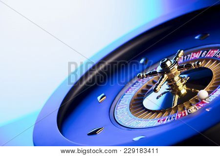 Casino. High Contrast Image Of Casino Roulette. Bokeh Background.