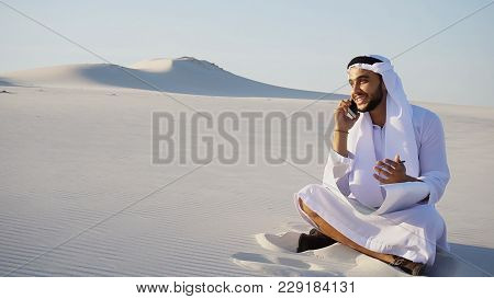 Modern Arabian Uae Sheikh Arab And Builder Dials On Cellular Customer To Clarify Stages Of Construct