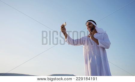 Happy, Handsome Guy, Emirate And Tourist, Conducts Dialogue Through Internet With Help Of Device, Wa