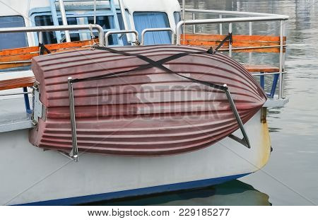 Closeup Of A Lifeboat Hanging On A Bigger Touristic Boat