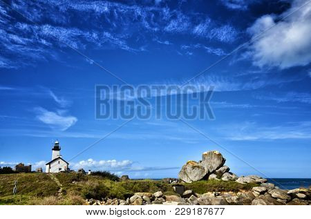 Phare de Pontusval, small lighthouse in the rocks on the beach at Brignogan-Plage, Brittany, France