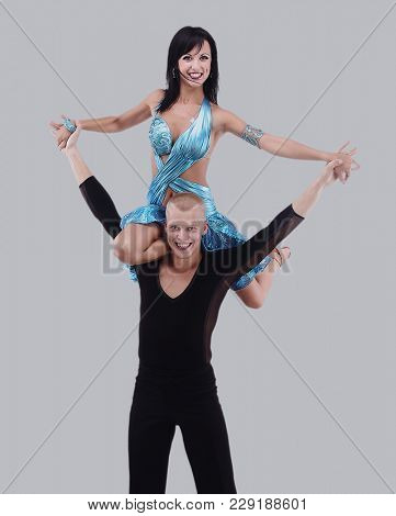 Latino dancers posing. Isolated on gray background