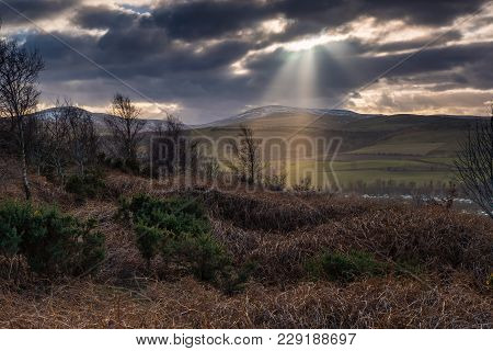 Crepuscular Rays Over The Cheviot Hills, The Sunbeams Near Wooler A Small Market Town In Northumberl