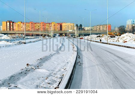 Snow-covered Road To The City, Road Junction Overpass And High-rise Buildings In The Winter In The S