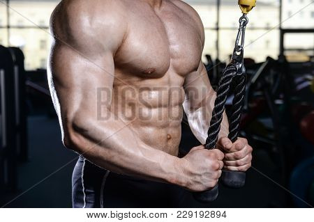 Brutal Strong Bodybuilder Athletic Men Pumping Up Muscles With Dumbbells