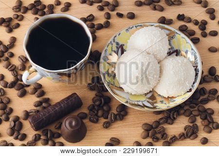 A Cup Of Invigorating Coffee With Air Cookies And Chocolate