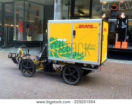 Düsseldorf, Germany - February 28, 2018: Dhl Inner-city Electric Delivery Cargo Bike